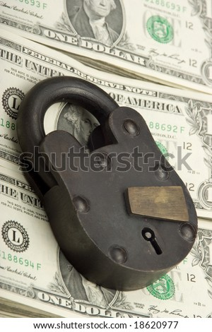 big lock on pile of cash FINANCIAL SECURITY CONCEPT - stock photo