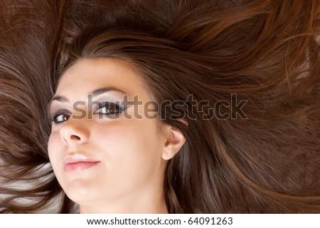 Big , long brown hair brunette closeup - stock photo