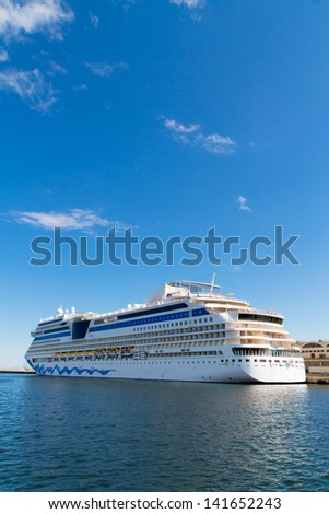 big long travel cruise ship - blue sky and water - - stock photo