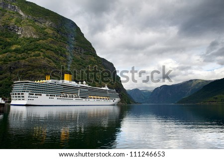 Big luxury cruise liner in the port of Flam reflecting in still clear waters of the fjord, Norway - stock photo