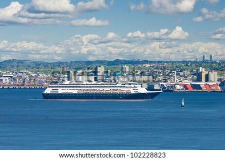 Big luxury cruise ship sailing ( arriving ) from port. Vancouver. Canada. - stock photo