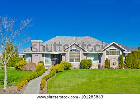 Big luxury home with the blue sky as a background. Vancouver, Canada. - stock photo