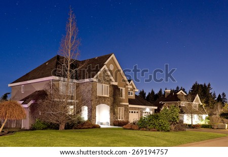 Big luxury house at dusk, night in suburb of Vancouver, Canada. - stock photo