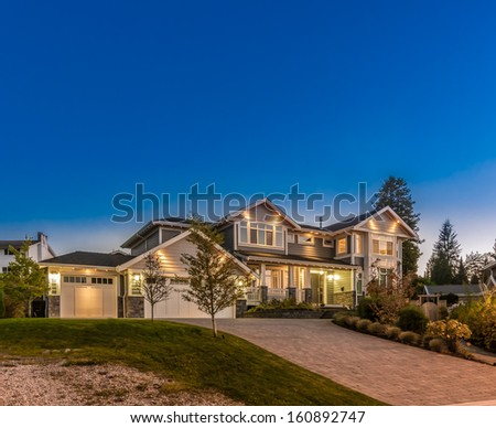Big luxury house at dusk, night, sunrise time in suburbs of Vancouver, Canada. - stock photo