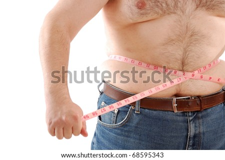big man measuring his belly with a measuring tape - stock photo