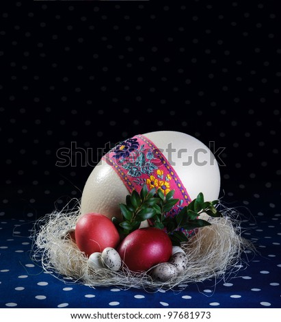 Big, medium and small easter eggs - stock photo