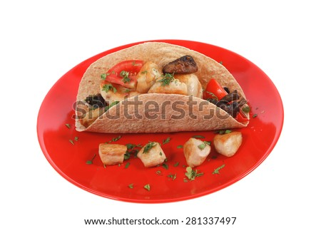 big mexican taco with tomatoes and mushroom on red plate isolated over white background - stock photo