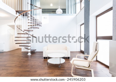 Big modern main room with coffee table and chairs - stock photo