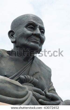 Big monk statue at Huay mongkol temple - stock photo