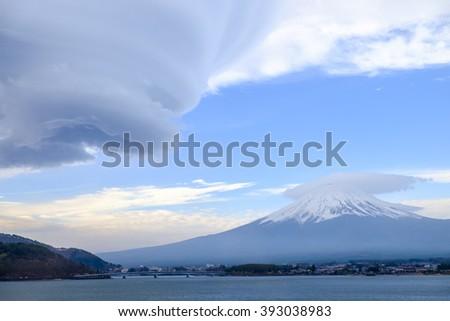 big moving cloud to mount Fuji - stock photo