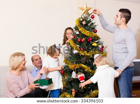 big multigenerational family with decorated Christmas tree - stock photo
