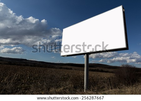 Big oblong white blank advertising billboard and clouds in sky - stock photo