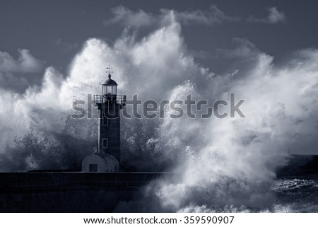 Big ocean stormy waves over old lighthouse of Douro mouth granite pier. Used infrared filter. Low edition photo. Toned blue. - stock photo