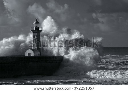 Big ocean stormy waves over old lighthouse of Douro mouth granite pier. Used infrared filter. Toned blue. - stock photo