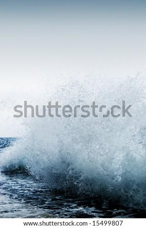 Big ocean wave breaking the shore - stock photo
