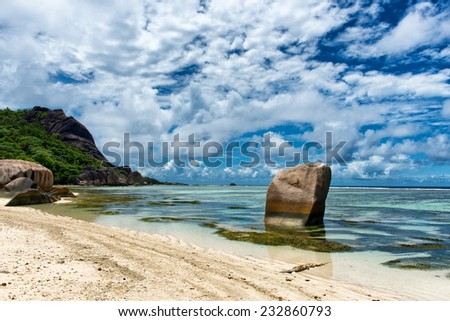 Big Old Rocks on Clear Water Lagoon at Anse Source d'Argent in La Digue Island, Seychelles - stock photo