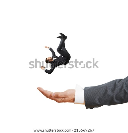 big palm catching small frightened businessman. isolated on white background - stock photo