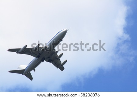 Big passenger airplane on background with blue sky and clouds - stock photo