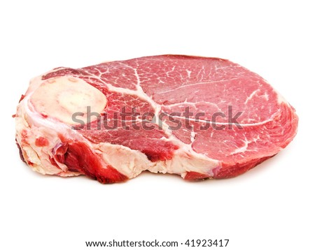 Big piece of raw meat against the white background - stock photo