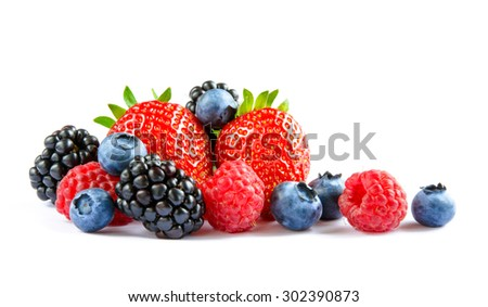 Big Pile of Fresh Berries on the White Background. Ripe Sweet Strawberry, Raspberry, Blueberry, Blackberry - stock photo