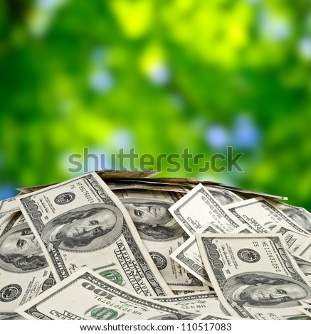 big pile of money. stack of american dollars - stock photo