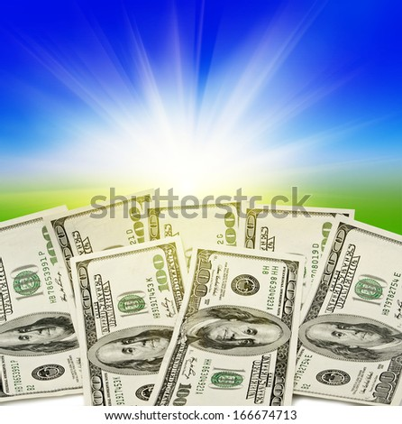 big pile of money. stack of american dollars on the sky, field backgrounds - stock photo