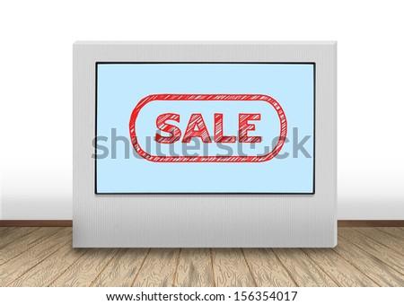 big plasma panel with sale on wall - stock photo