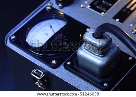 big plug with power cable and voltmeter (generator) - stock photo