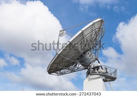 Big radar parabolic radio antenna global telecommunication technology equipment for information data streaming broadcast - stock photo