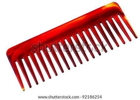 Big red and brown comb isolated over white background. - stock photo