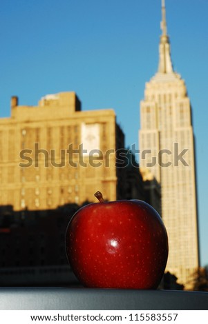 Big Red Apple and Empire State Building concepts of New York City - stock photo