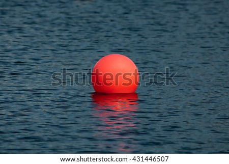 Big red ball in the lake - stock photo