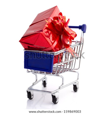Big red gift box in shopping cart - stock photo