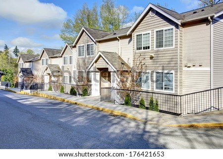 Big residential siding house with drive way - stock photo