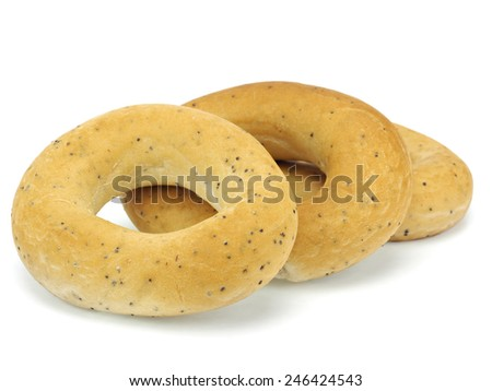 Big ring bagels with poppy seeds on a white background - stock photo