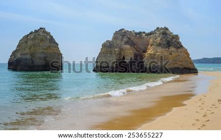 Big rocks the ocean on beach, Praia da Rocha, Rock Beach, Portugal - stock photo