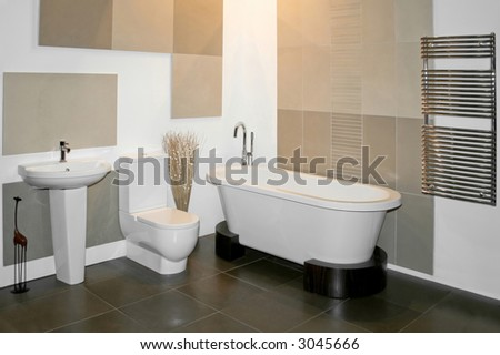 Big round bath and toilet in bathroom - stock photo