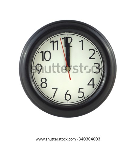 Big round wall clock in dark case shows almost twelve o'clock  isolated on white closeup - stock photo