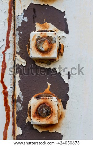 Big rusty metal nuts locked with rust and corrosion bolts at high mast pole - stock photo
