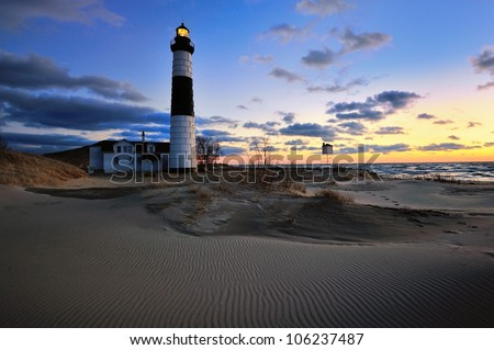 Big Sable Point Lighthouse Sunset, patterns in the sand ,Lake Michigan - stock photo