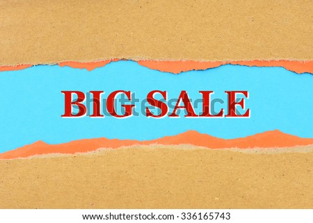 BIG SALE on a torn paper - stock photo