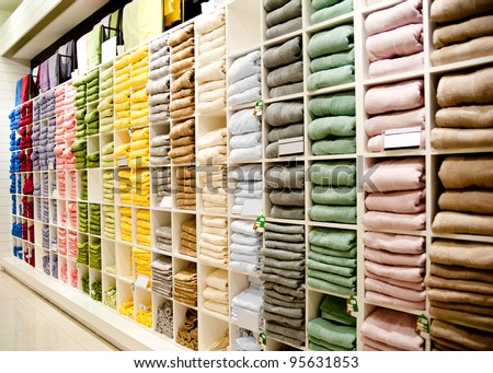 Big shelf with a colorful towels - stock photo