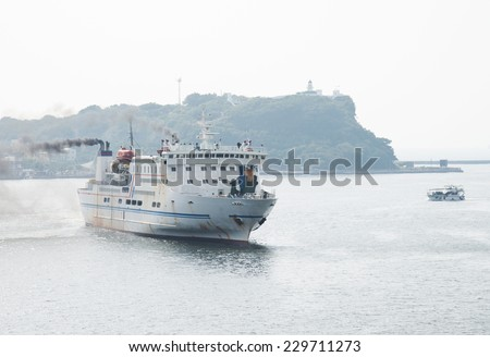 Big ship arriving in the port. - stock photo