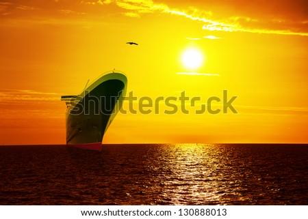 Big ship on sunrise in the sea. - stock photo