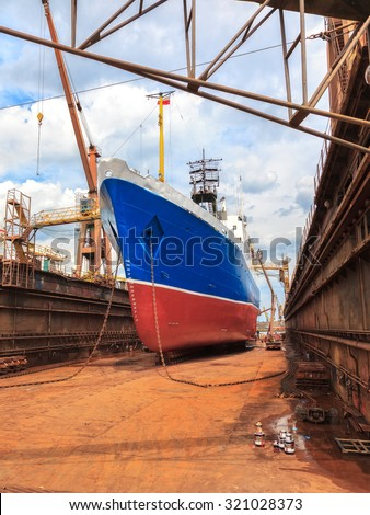 Big ship - rear view with propeller under repair. - stock photo