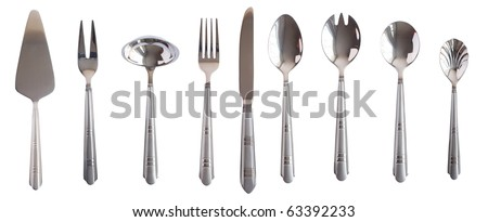 Big silver kitchen table set spoon fork knife isolated. More images of this models you can find in my portfolio - stock photo