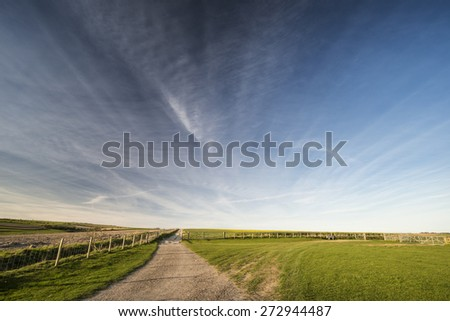 Big sky Spring landscape in late evening light - stock photo