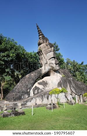 Big sleep buddhist at Buddha park,Wat xiengkuane, Vientiane, Laos. - stock photo