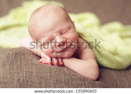 Big smile, newborn baby boy - stock photo