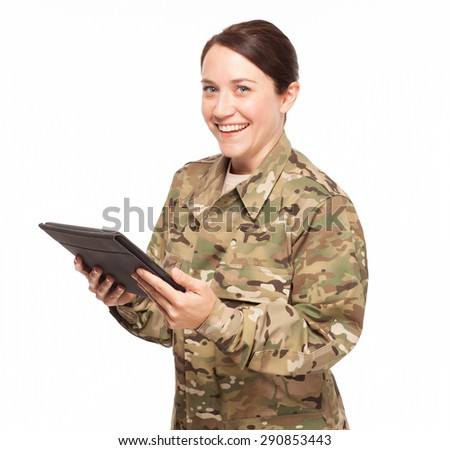 Big smile on female soldier with digital tablet wearing multicam camouflage. - stock photo